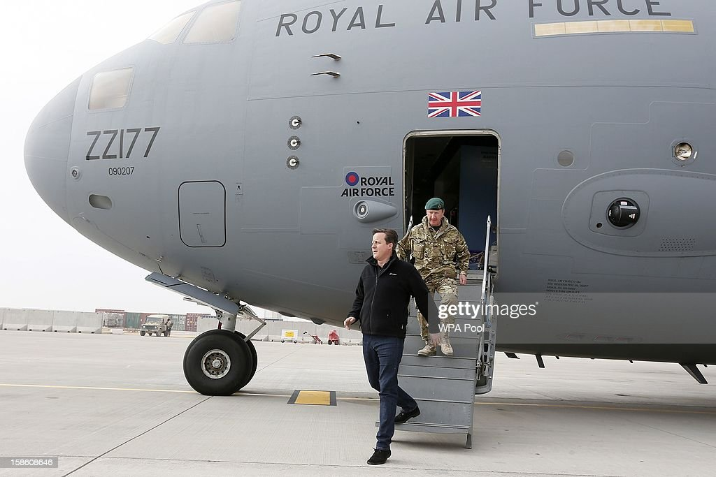 British Prime Minister David Cameron arrives for a visit at Camp Bastion, outside Lashkar Gah on December 20, 2012 in Helmand Province, Afghanistan. Prime Minister Cameron is making a Christmas visit to British troops in the region amid tight security.