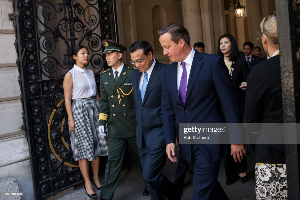 British Prime Minister David Cameron (right) arrives in Downing Street with Chinese Premier <a gi-track='captionPersonalityLinkClicked' href=/galleries/search?phrase=Li+Keqiang&family=editorial&specificpeople=2481781 ng-click='$event.stopPropagation()'>Li Keqiang</a> on June 17, 2014 in London, England. During his first official visit to the UK Mr Li will hold talks with British Prime Minister David Cameron and met the Queen at Windsor Castle. At the start of Mr Li's three-day visit, the Home Office announced a new visa service, to be offered to all Chinese visitors to the UK following a pilot programme for tour operators last year.