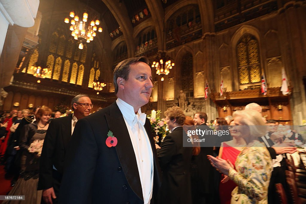 British Prime Minister <a gi-track='captionPersonalityLinkClicked' href=/galleries/search?phrase=David+Cameron+-+Politician&family=editorial&specificpeople=227076 ng-click='$event.stopPropagation()'>David Cameron</a> arrives in the Guildhall to attend The Lord Mayor's Banquet on November 11, 2013 in London, England. The New Lord Mayor of London Fiona Woolf is hosting the annual Lord Mayor's Banquet in London's Guildhall which will feature speeches from the Prime Minister and the Archbishop of Canterbury. Alderman Fiona Woolf has been elected as 686th Lord Mayor of the City of London and the second ever woman to hold the role.