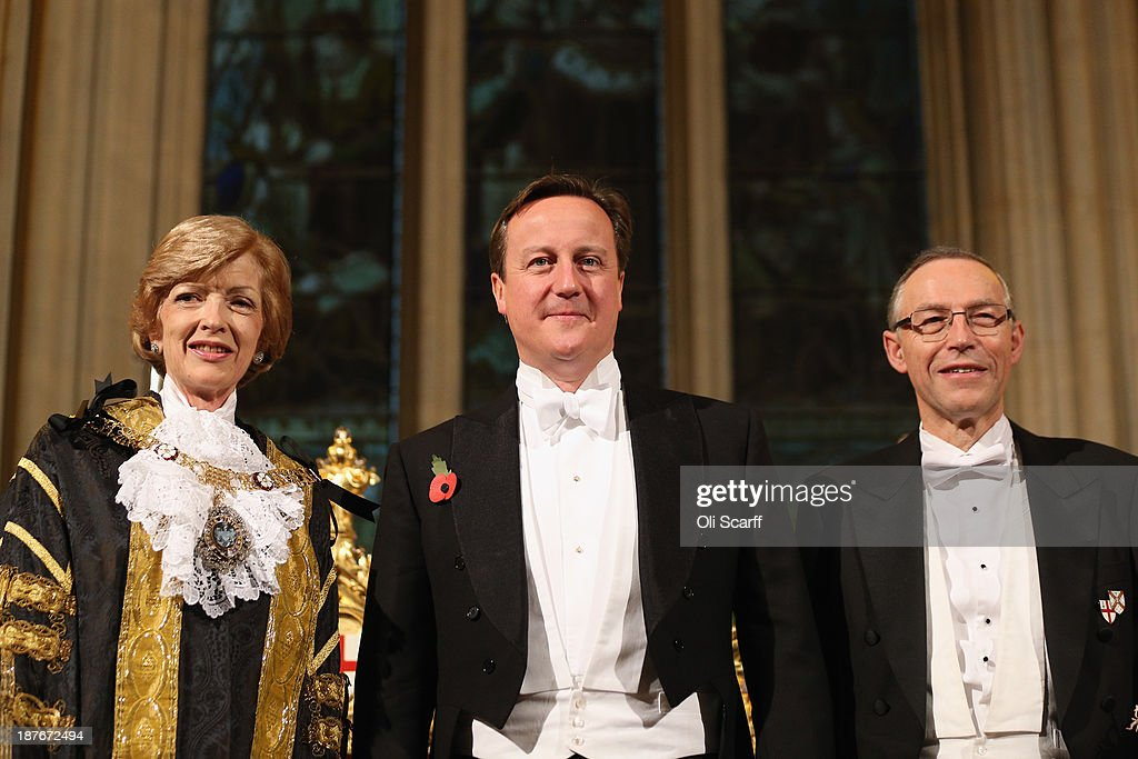 British Prime Minister David Cameron (C) arrives in the Guildhall to attend The Lord Mayor's Banquet on November 11, 2013 in London, England. The New Lord Mayor of London <a gi-track='captionPersonalityLinkClicked' href=/galleries/search?phrase=Fiona+Woolf&family=editorial&specificpeople=10291022 ng-click='$event.stopPropagation()'>Fiona Woolf</a> is hosting the annual Lord Mayor's Banquet in London's Guildhall which will feature speeches from the Prime Minister and the Archbishop of Canterbury. Alderman <a gi-track='captionPersonalityLinkClicked' href=/galleries/search?phrase=Fiona+Woolf&family=editorial&specificpeople=10291022 ng-click='$event.stopPropagation()'>Fiona Woolf</a> has been elected as 686th Lord Mayor of the City of London and the second ever woman to hold the role. From left to right: Lord Mayor of London <a gi-track='captionPersonalityLinkClicked' href=/galleries/search?phrase=Fiona+Woolf&family=editorial&specificpeople=10291022 ng-click='$event.stopPropagation()'>Fiona Woolf</a>; Prime Minister David Cameron; Nicholas Woolf, the Lord Mayor's husband.