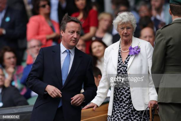 British Prime Minister David Cameron arrives with his mother Mary Cameron in the royal box on centre court before the men's singles final match on...