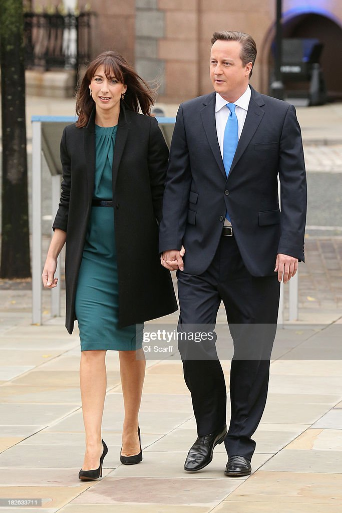 British Prime Minister <a gi-track='captionPersonalityLinkClicked' href=/galleries/search?phrase=David+Cameron+-+Politician&family=editorial&specificpeople=227076 ng-click='$event.stopPropagation()'>David Cameron</a> (R) arrives with his wife <a gi-track='captionPersonalityLinkClicked' href=/galleries/search?phrase=Samantha+Cameron&family=editorial&specificpeople=624344 ng-click='$event.stopPropagation()'>Samantha Cameron</a> before delivering his keynote speech on the last day of the annual Conservative Party Conference at Manchester Central on October 2, 2013 in Manchester, England. During his closing speech <a gi-track='captionPersonalityLinkClicked' href=/galleries/search?phrase=David+Cameron+-+Politician&family=editorial&specificpeople=227076 ng-click='$event.stopPropagation()'>David Cameron</a> will say that his 'abiding mission' would make the UK into a 'land of opportunity'.