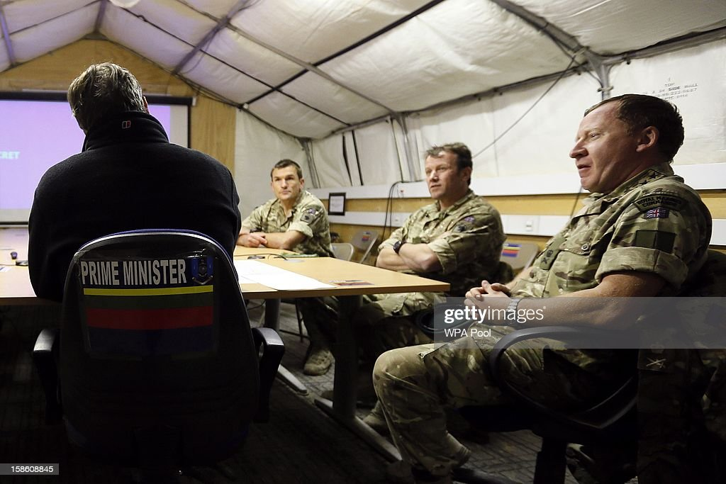 British Prime Minister David Cameron attends a meeting with Royal Marines during a visit to Forward Operating Base Price on December 20, 2012 in Helmand Province, Afghanistan. Prime Minister Cameron is making a Christmas visit to British troops in the region amid tight security.