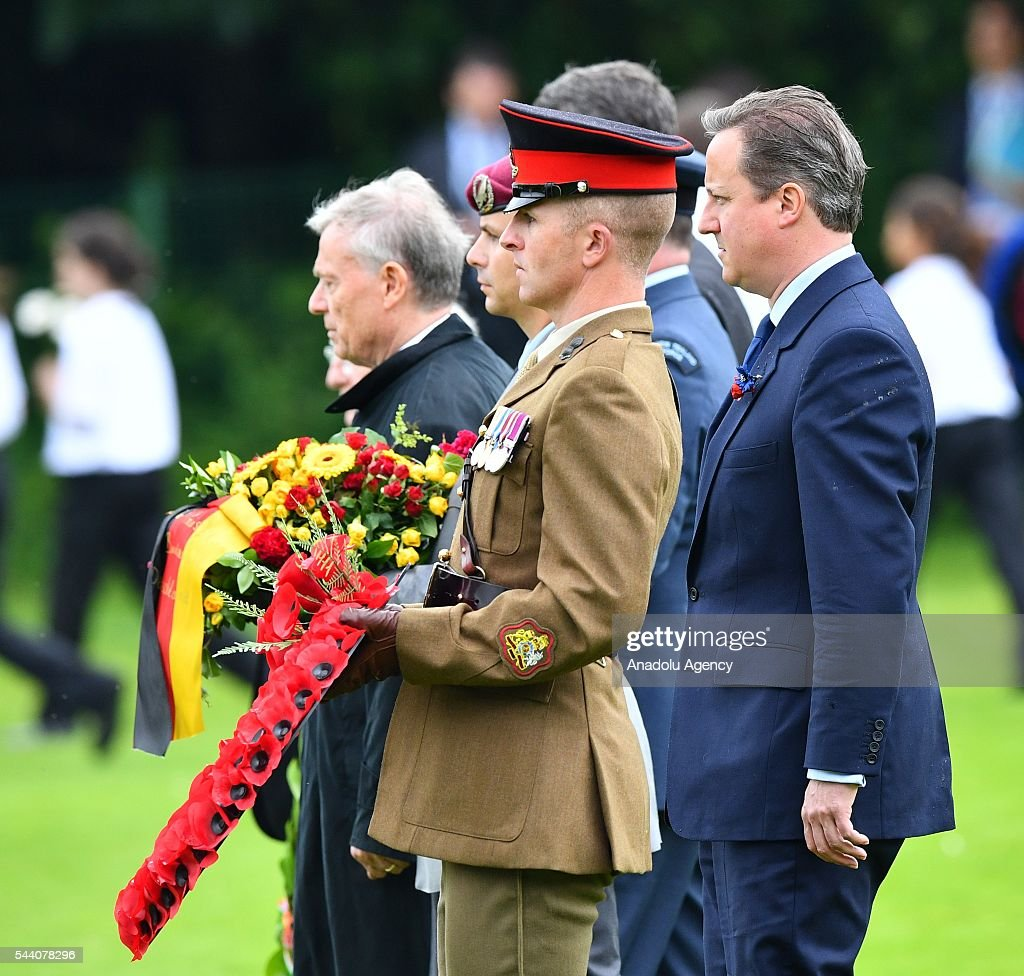 British Prime Minister David Cameron (R) attends the ceremony to mark the centenary of the Battle of the Somme at the Thiepval monument, in Thiepval, near Amiens, northern France on July 01, 2016. The Battle of the Somme remains as one of the most deadly battles of the First World War.