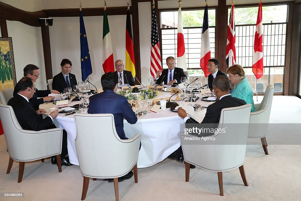 British Prime Minister David Cameron, Canadian Prime Minister Justin Trudeau, European Commission President Jean-Claude Juncker, European Council President Donald Tusk, Italian Prime Minister Matteo Renzi, German Chancellor Angela Merkel, US President Barack Obama, and Japanese Prime Minister Shinzo Abe attend working lunch during the first day of the G7 leaders summit in the city of Ise in Mie prefecture, Japan on May 26, 2016.