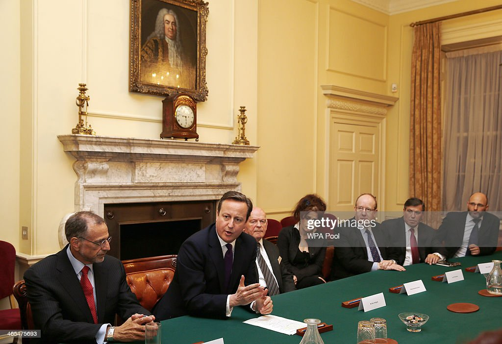 British Prime Minister David Cameron (2nd L) chairs a meeting of the Holocaust Commission prior to a reception for survivors of the Holocaust to commemorate International Holocaust Remembrance Day at 10 Downing Street on January 27, 2014, in London, England. The Prime Minister has announced that actress Helena Bonham Carter, broadcaster Natasha Kaplinsky, chief rabbi Ephraim Mirvis and a selection of politicians and businessmen will sit on the Holocaust Commission, which will discuss ways to ensure future generations will not forget the events of the Holocaust.