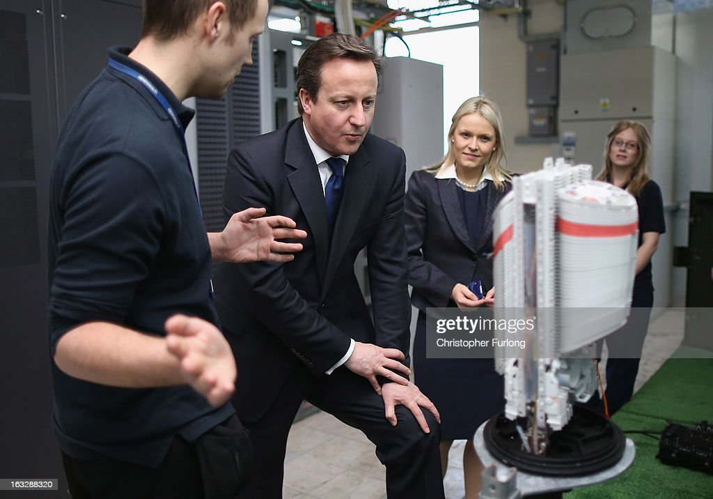 British Prime Minister <a gi-track='captionPersonalityLinkClicked' href=/galleries/search?phrase=David+Cameron+-+Politician&family=editorial&specificpeople=227076 ng-click='$event.stopPropagation()'>David Cameron</a> chats to Openreach apprentices as he tours a telephone exchange accompanied by Chief Executive of Openreach Liv Garfield (2nd R) on the day BT Openreach announce that they are creating more than 1,000 engineering jobs on March 7, 2013 in Pudsey, England. During his visit to West Yorkshire the prime minister emphasised that he will hold firm on the economy and that any change in the governments route to economic recovery would plunge the UK 'back into the abyss'.