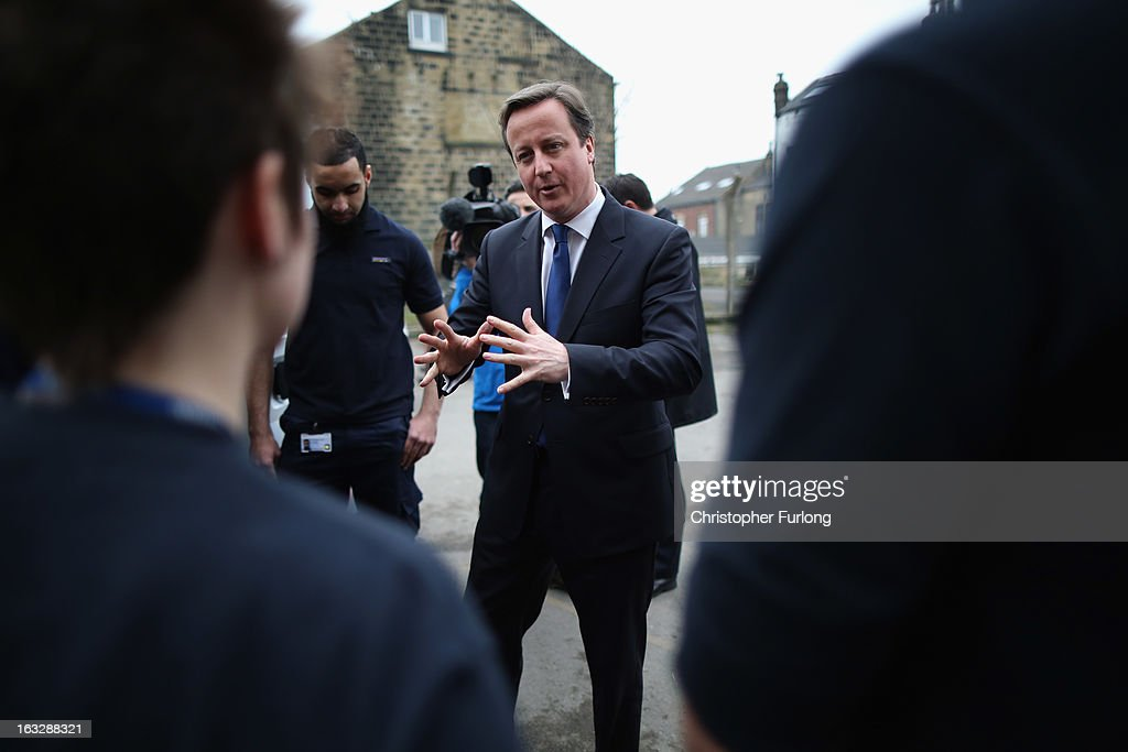 British Prime Minister <a gi-track='captionPersonalityLinkClicked' href=/galleries/search?phrase=David+Cameron+-+Politician&family=editorial&specificpeople=227076 ng-click='$event.stopPropagation()'>David Cameron</a> chats to Openreach apprentices as he tours a telephone exchange on the day as BT Openreach announce that they are creating more than 1,000 engineering jobs on March 7, 2013 in Pudsey, England. During his visit to West Yorkshire the prime minister emphasised that he will hold firm on the economy and that any change in the governments route to economic recovery would plunge the UK 'back into the abyss'.