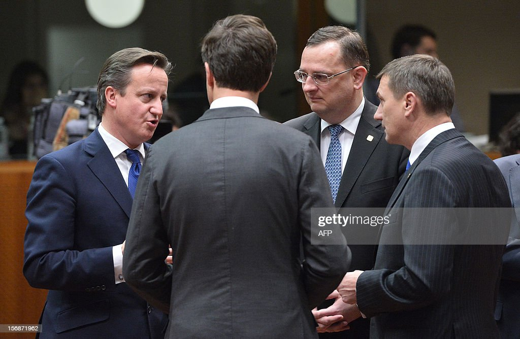 British Prime Minister David Cameron (L) chats with Czech Prime Minister Petr Necas and Estonian Prime Minister Andrus Ansip (R) at the EU Headquarters on November 22, 2012 in Brussels, during a two-day European Union leaders summit called to agree a hotly-contested trillion-euro budget through 2020. European Union officials were scrambling to find an all but impossible compromise on the 2014-2020 budget that could successfully move richer nations looking for cutbacks closer to poorer ones who look to Brussels to prop up hard-hit industries and regions.