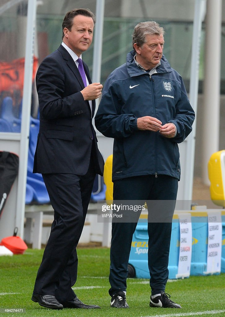 British Prime Minister David Cameron (L) chats with England football manager <a gi-track='captionPersonalityLinkClicked' href=/galleries/search?phrase=Roy+Hodgson&family=editorial&specificpeople=881703 ng-click='$event.stopPropagation()'>Roy Hodgson</a> during his visit to England's football training headquaters at St Georges Park on May 29, 2014 in Burton-Upon-Trent, England. Cameron was on the field also to meet England's World Cup Football Team.