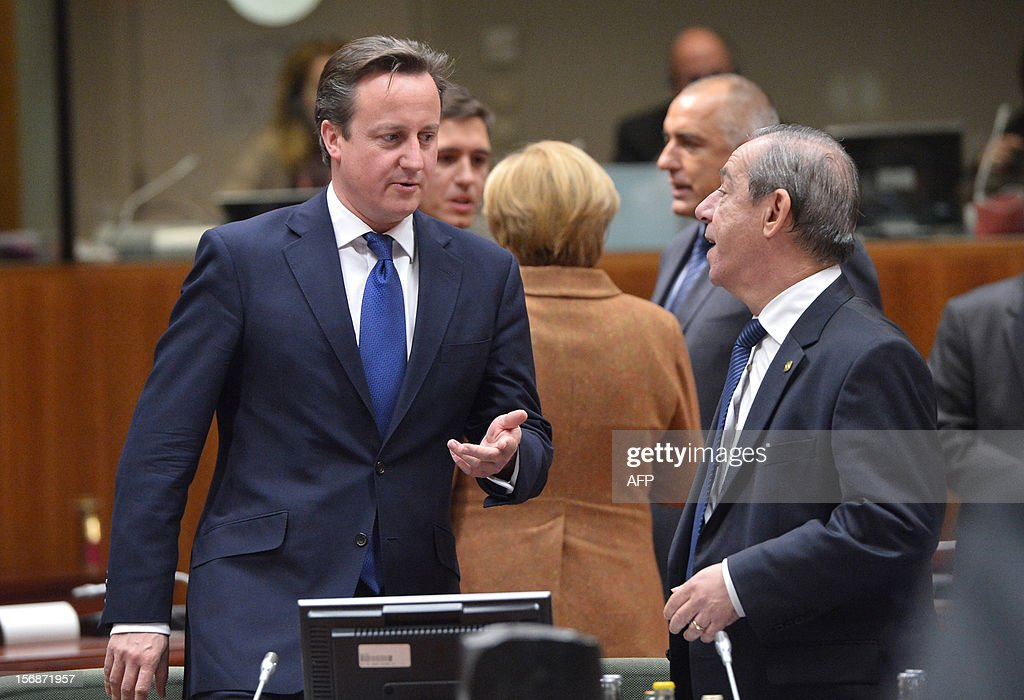 British Prime Minister David Cameron chats with Maltese Prime Minister Lawrence Gonzi at the EU Headquarters on November 22 2012 in Brussels during a...
