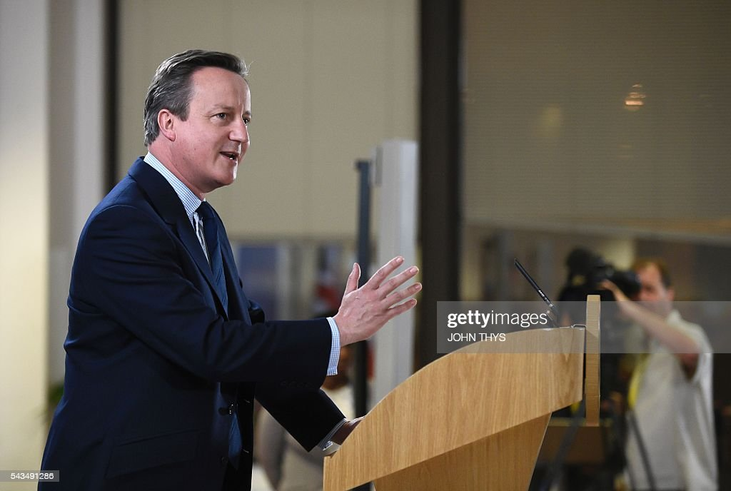British Prime minister David Cameron delivers a speech during a European Union summit on June 28, 2016 at the EU headquarters in Brussels. Britain's exit from the European Union may erode the bloc's leadership role in fighting climate change and stymie crucial efforts to set more ambitious targets for cutting greenhouse gases, officials and experts said on June 28. European leaders meeting in Brussels pressured British Prime Minister David Cameron Tuesday to launch the two-year withdrawal process 'as soon as possible', but the embattled premier has vowed he will leave that task to a successor to be named on September 9. / AFP / JOHN
