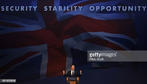 British Prime Minister David Cameron delivers a speech to delegates on the final day of the annual Conservative Party Conference in Manchester north...