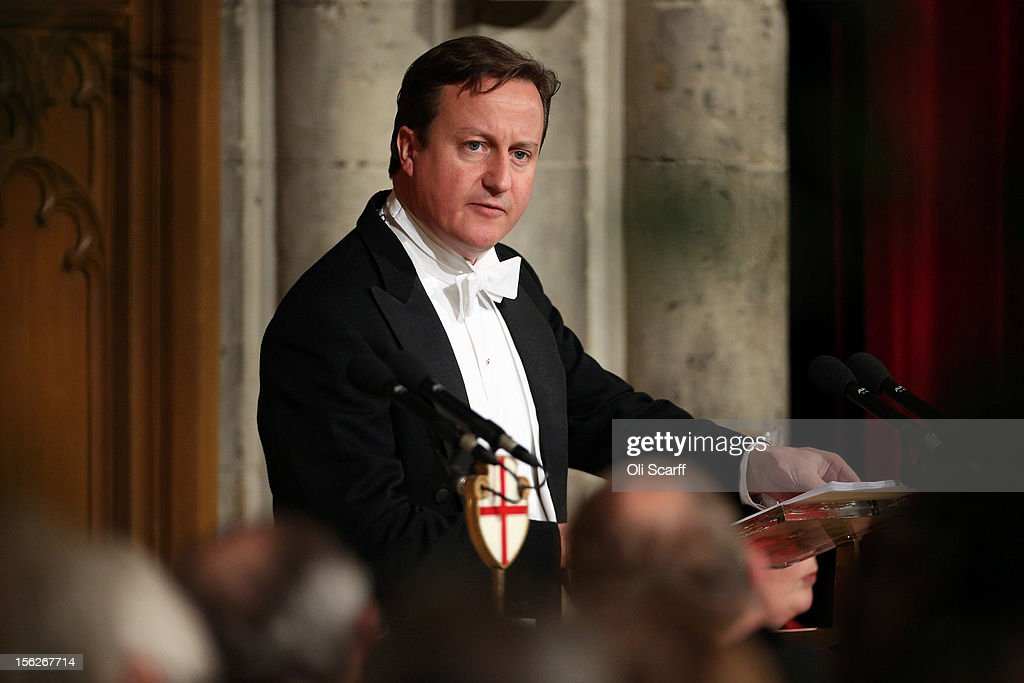 British Prime Minister <a gi-track='captionPersonalityLinkClicked' href=/galleries/search?phrase=David+Cameron+-+Politiker&family=editorial&specificpeople=227076 ng-click='$event.stopPropagation()'>David Cameron</a> delivers a speech to guests in the Guildhall during The Lord Mayor's Banquet on November 12, 2012 in London, England. The New Lord Mayor of London Roger Gifford is hosting the annual Lord Mayor's Banquet in London's Guildhall which will feature speeches from the Prime Minister and the Archbishop of Canterbury.
