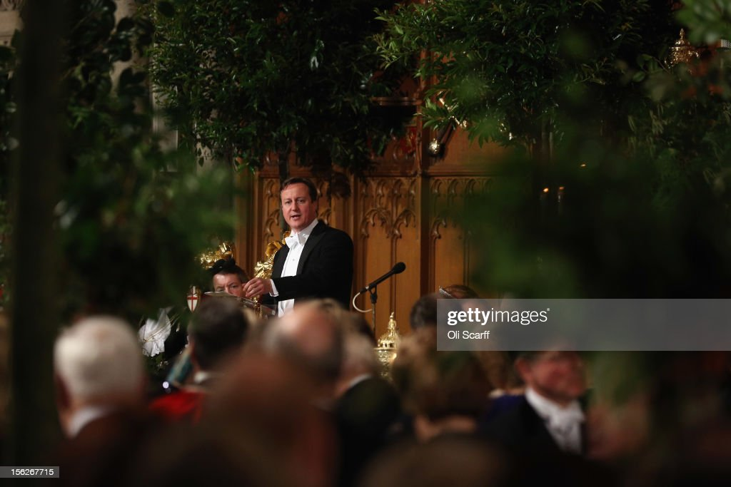 British Prime Minister <a gi-track='captionPersonalityLinkClicked' href=/galleries/search?phrase=David+Cameron+-+Politician&family=editorial&specificpeople=227076 ng-click='$event.stopPropagation()'>David Cameron</a> (C) delivers a speech to guests in the Guildhall during The Lord Mayor's Banquet on November 12, 2012 in London, England. The New Lord Mayor of London Roger Gifford is hosting the annual Lord Mayor's Banquet in London's Guildhall which will feature speeches from the Prime Minister and the Archbishop of Canterbury.