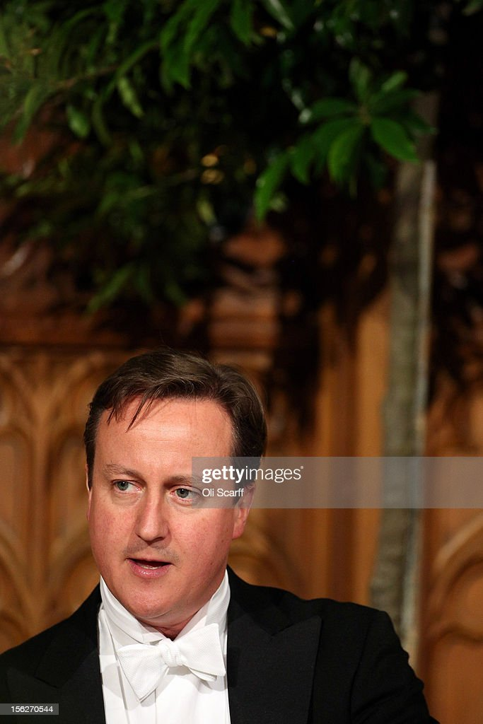 British Prime Minister <a gi-track='captionPersonalityLinkClicked' href=/galleries/search?phrase=David+Cameron+-+Politician&family=editorial&specificpeople=227076 ng-click='$event.stopPropagation()'>David Cameron</a> delivers a speech to guests in the Guildhall during The Lord Mayor's Banquet on November 12, 2012 in London, England. The New Lord Mayor of London Roger Gifford is hosting the annual Lord Mayor's Banquet in London's Guildhall which will feature speeches from the Prime Minister and the Archbishop of Canterbury.