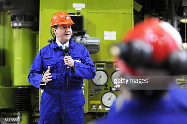British Prime Minister David Cameron delivers a speech to workers in the Charge Hall at Hinkley Point B on October 21 French energy giant EDF said on...