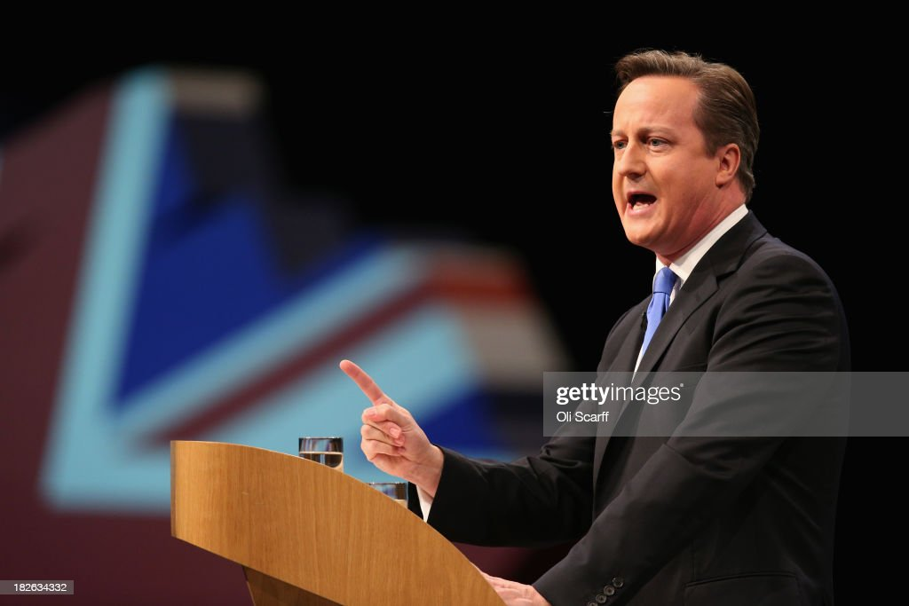 British Prime Minister <a gi-track='captionPersonalityLinkClicked' href=/galleries/search?phrase=David+Cameron+-+Politician&family=editorial&specificpeople=227076 ng-click='$event.stopPropagation()'>David Cameron</a> delivers his keynote speech on the last day of the annual Conservative Party Conference at Manchester Central on October 2, 2013 in Manchester, England. During his closing speech <a gi-track='captionPersonalityLinkClicked' href=/galleries/search?phrase=David+Cameron+-+Politician&family=editorial&specificpeople=227076 ng-click='$event.stopPropagation()'>David Cameron</a> will say that his 'abiding mission' would make the UK into a 'land of opportunity'.