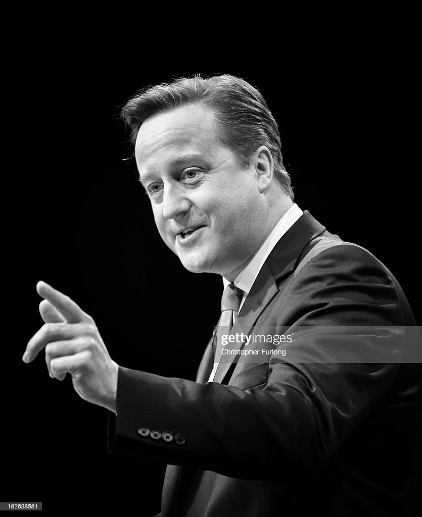 British Prime Minister <a gi-track='captionPersonalityLinkClicked' href=/galleries/search?phrase=David+Cameron+-+Politician&family=editorial&specificpeople=227076 ng-click='$event.stopPropagation()'>David Cameron</a> delivers his keynote speech to delegates on the last day of the annual Conservative Party Conference at Manchester Central on October 2, 2013 in Manchester, England. During his closing speech <a gi-track='captionPersonalityLinkClicked' href=/galleries/search?phrase=David+Cameron+-+Politician&family=editorial&specificpeople=227076 ng-click='$event.stopPropagation()'>David Cameron</a> said that his 'abiding mission' would make the UK into a 'land of opportunity'.