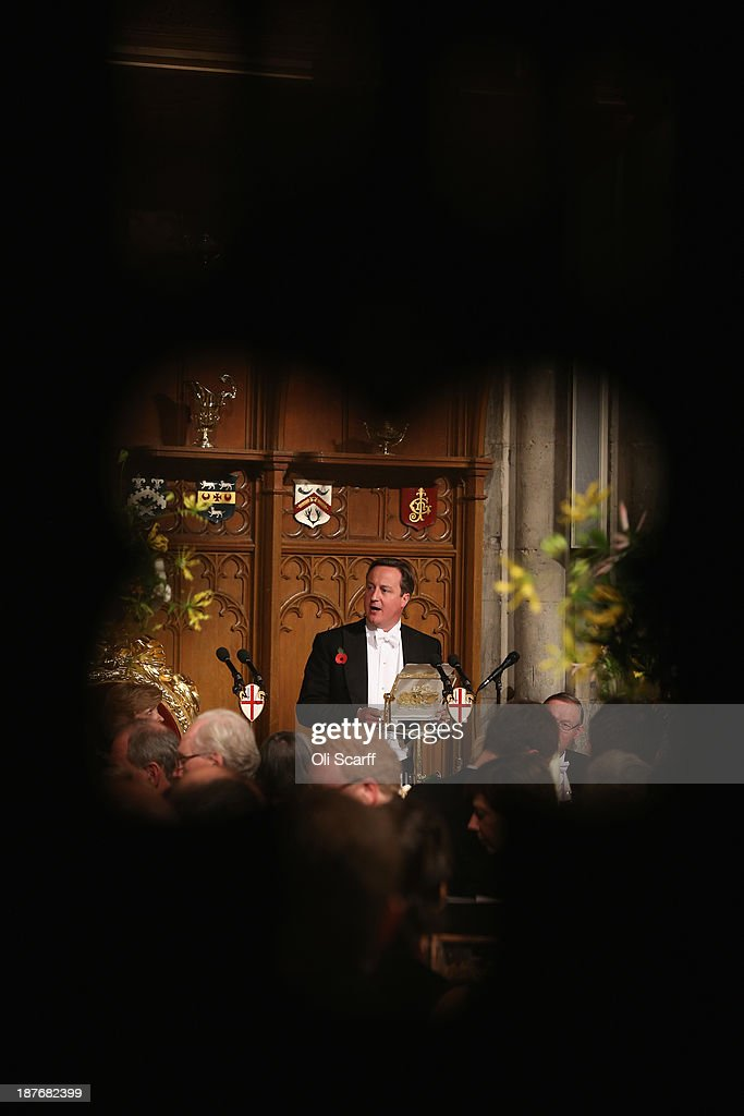 British Prime Minister <a gi-track='captionPersonalityLinkClicked' href=/galleries/search?phrase=David+Cameron+-+Politician&family=editorial&specificpeople=227076 ng-click='$event.stopPropagation()'>David Cameron</a> delivers his speech in the Guildhall during The Lord Mayor's Banquet on November 11, 2013 in London, England. The New Lord Mayor of London Fiona Woolf is hosting the annual Lord Mayor's Banquet in London's Guildhall which will feature speeches from the Prime Minister and the Archbishop of Canterbury. Alderman Fiona Woolf has been elected as 686th Lord Mayor of the City of London and the second ever woman to hold the role.