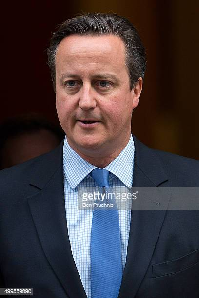 British Prime Minister David Cameron departs Number 10 Downing Street on December 2 2015 in London England British MPs are expected to vote tonight...