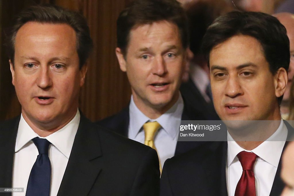 British Prime Minister David Cameron Deputy Prime Minister and leader of the Liberal Democrats Nick Clegg Leader of the Labour Party Ed Miliband walk...