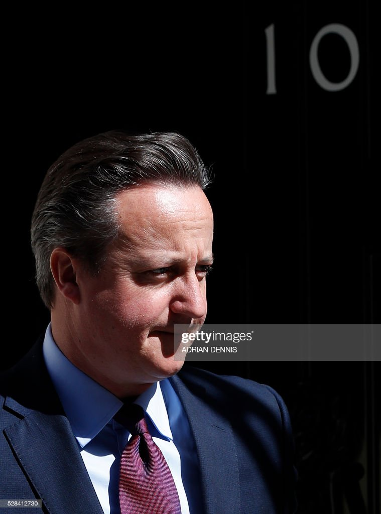 British Prime Minister David Cameron exits 10 Downing Street in central London on May 5, 2016, as he waits to greet Japanese Prime Minister Shinzo Abe ahead of their meeting. / AFP / ADRIAN