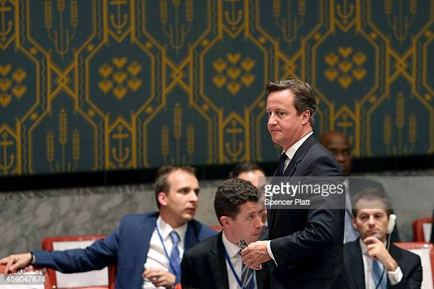 British Prime Minister David Cameron exits a Security Council meeting on global terrorism during the United Nations General Assembly on September 24...