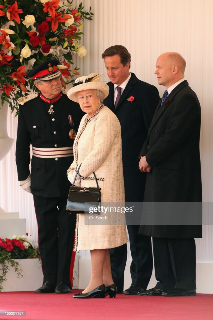 British Prime Minister <a gi-track='captionPersonalityLinkClicked' href=/galleries/search?phrase=David+Cameron+-+Politician&family=editorial&specificpeople=227076 ng-click='$event.stopPropagation()'>David Cameron</a> (2nd R), Foreign Secretary <a gi-track='captionPersonalityLinkClicked' href=/galleries/search?phrase=William+Hague&family=editorial&specificpeople=206295 ng-click='$event.stopPropagation()'>William Hague</a> (R) stand with Queen <a gi-track='captionPersonalityLinkClicked' href=/galleries/search?phrase=Elizabeth+II&family=editorial&specificpeople=67226 ng-click='$event.stopPropagation()'>Elizabeth II</a> (2nd L) before a Ceremonial Welcome in Horse Guards Parade at the start of Susilo Bambang Yudhoyono's, the President of the Republic of Indonesia, State Visit to the UK on October 31, 2012 in London, England. During President Yudhoyono and his wife's three day State Visit to the UK they will stay in Buckingham Palace and meet with members of the Royal Family, Prime Minister <a gi-track='captionPersonalityLinkClicked' href=/galleries/search?phrase=David+Cameron+-+Politician&family=editorial&specificpeople=227076 ng-click='$event.stopPropagation()'>David Cameron</a> and lay a wreath at the Grave of the Unknown Warrior in Westminster Abbey.