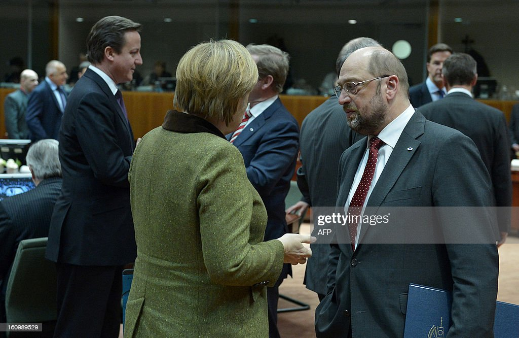 British Prime Minister David Cameron, German Chancellor Angela Merkel, Irish Prime Minister Enda Kenny and European Parliament President Martin Schulz chat during a roundtable meeting at the EU Headquarters on February 7, 2013 in Brussels, on the first day of a two-day European Union leaders summit. European Union leaders head into a fresh clash over the EU's budget with the only certainty being that proposals for several years will be cut back. AFP PHOTO / BERTRAND LANGLOIS