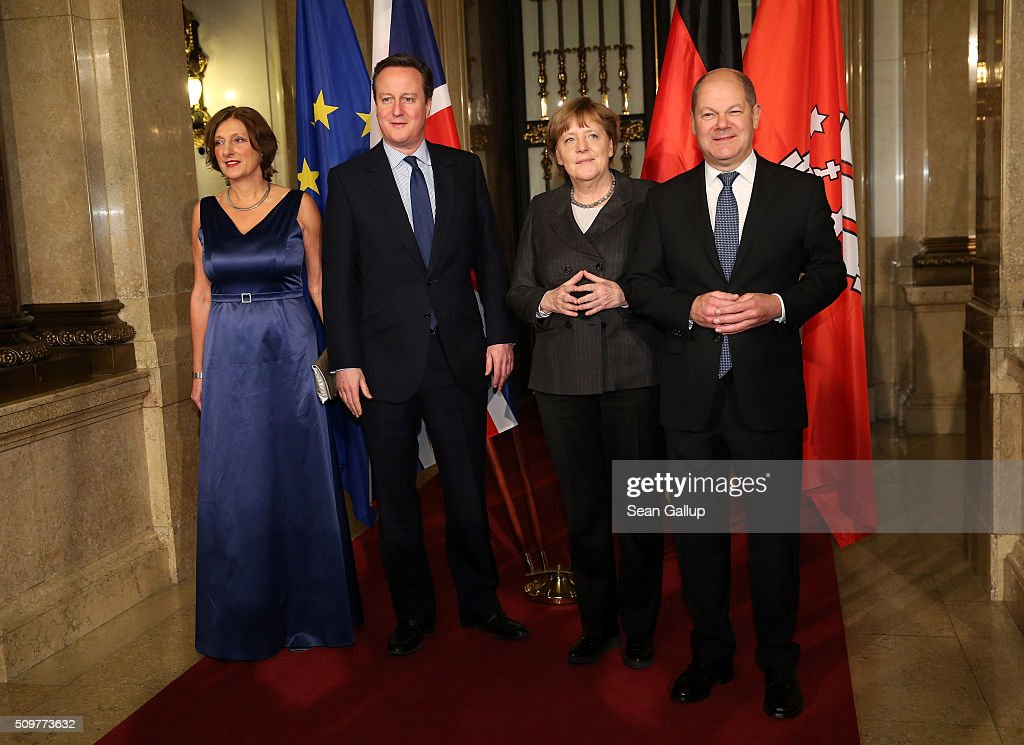 British Prime Minister <a gi-track='captionPersonalityLinkClicked' href=/galleries/search?phrase=David+Cameron+-+Politician&family=editorial&specificpeople=227076 ng-click='$event.stopPropagation()'>David Cameron</a> (2L), German Chancellor <a gi-track='captionPersonalityLinkClicked' href=/galleries/search?phrase=Angela+Merkel&family=editorial&specificpeople=202161 ng-click='$event.stopPropagation()'>Angela Merkel</a> (2R) Hamburg's Mayor <a gi-track='captionPersonalityLinkClicked' href=/galleries/search?phrase=Olaf+Scholz&family=editorial&specificpeople=2162609 ng-click='$event.stopPropagation()'>Olaf Scholz</a> (R) and his wife Britta Ernst attend the annual Matthiae-Mahl dinner at Hamburg City Hall on February 12, 2016 in Hamburg, Germany. The two leaders are there on the invitation of Hamburg Mayor <a gi-track='captionPersonalityLinkClicked' href=/galleries/search?phrase=Olaf+Scholz&family=editorial&specificpeople=2162609 ng-click='$event.stopPropagation()'>Olaf Scholz</a>, who reportedly saw the dinner as a gesture to show Germany's hope that Great Britain will remain in the European Union. The Matthiae-Mahl is a Hamburg tradition dating back to 1356 and began as a fest to welcome the spring season and also to honor a foreign official.