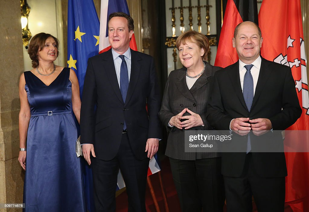 British Prime Minister <a gi-track='captionPersonalityLinkClicked' href=/galleries/search?phrase=David+Cameron+-+Politiker&family=editorial&specificpeople=227076 ng-click='$event.stopPropagation()'>David Cameron</a> (2L), German Chancellor <a gi-track='captionPersonalityLinkClicked' href=/galleries/search?phrase=Angela+Merkel&family=editorial&specificpeople=202161 ng-click='$event.stopPropagation()'>Angela Merkel</a> (2R), Hamburg's Mayor <a gi-track='captionPersonalityLinkClicked' href=/galleries/search?phrase=Olaf+Scholz&family=editorial&specificpeople=2162609 ng-click='$event.stopPropagation()'>Olaf Scholz</a> (R) and his wife Britta Ernst attend the annual Matthiae-Mahl dinner at Hamburg City Hall on February 12, 2016 in Hamburg, Germany. The two leaders are there on the invitation of Hamburg Mayor <a gi-track='captionPersonalityLinkClicked' href=/galleries/search?phrase=Olaf+Scholz&family=editorial&specificpeople=2162609 ng-click='$event.stopPropagation()'>Olaf Scholz</a>, who reportedly saw the dinner as a gesture to show Germany's hope that Great Britain will remain in the European Union. The Matthiae-Mahl is a Hamburg tradition dating back to 1356 and began as a fest to welcome the spring season and also to honor a foreign official.