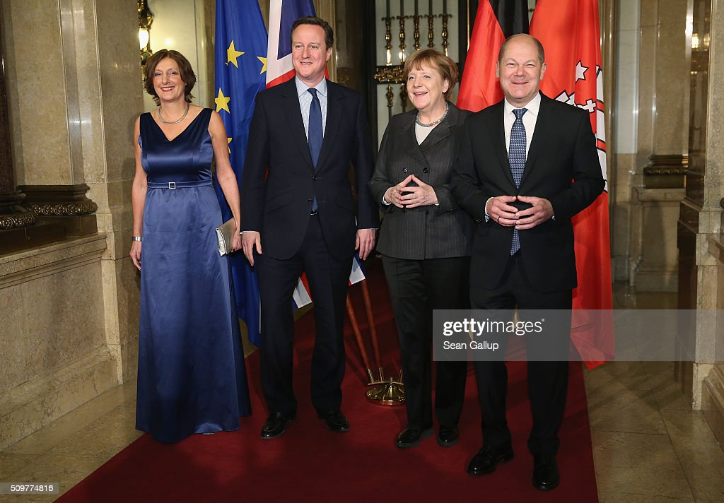 British Prime Minister David Cameron (2L), German Chancellor Angela Merkel (2R), Hamburg's Mayor Olaf Scholz (R) and his wife Britta Ernst attend the annual Matthiae-Mahl dinner at Hamburg City Hall on February 12, 2016 in Hamburg, Germany. The two leaders are there on the invitation of Hamburg Mayor Olaf Scholz, who reportedly saw the dinner as a gesture to show Germany's hope that Great Britain will remain in the European Union. The Matthiae-Mahl is a Hamburg tradition dating back to 1356 and began as a fest to welcome the spring season and also to honor a foreign official.