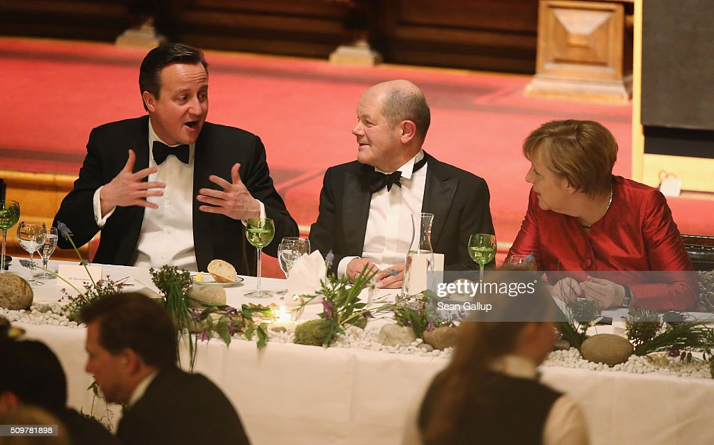 British Prime Minister David Cameron (L), German Chancellor Angela Merkel (R) and Hamburg's Mayor Olaf Scholz attend the annual Matthiae-Mahl dinner at Hamburg City Hall on February 12, 2016 in Hamburg, Germany. The two leaders are there on the invitation of Hamburg Mayor Olaf Scholz, who reportedly saw the dinner as a gesture to show Germany's hope that Great Britain will remain in the European Union. The Matthiae-Mahl is a Hamburg tradition dating back to 1356 and began as a fest to welcome the spring season and also to honor a foreign official.