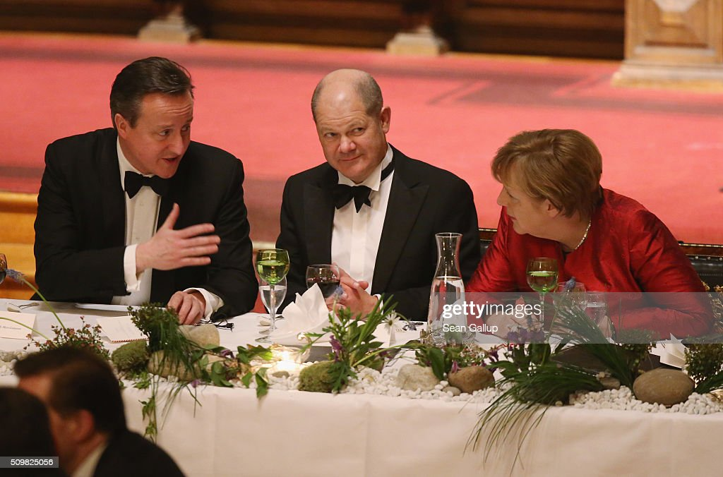 British Prime Minister <a gi-track='captionPersonalityLinkClicked' href=/galleries/search?phrase=David+Cameron+-+Politiker&family=editorial&specificpeople=227076 ng-click='$event.stopPropagation()'>David Cameron</a> (L), German Chancellor <a gi-track='captionPersonalityLinkClicked' href=/galleries/search?phrase=Angela+Merkel&family=editorial&specificpeople=202161 ng-click='$event.stopPropagation()'>Angela Merkel</a> (R) and Hamburg Mayor <a gi-track='captionPersonalityLinkClicked' href=/galleries/search?phrase=Olaf+Scholz&family=editorial&specificpeople=2162609 ng-click='$event.stopPropagation()'>Olaf Scholz</a> attend the annual Matthiae-Mahl dinner at Hamburg City Hall on February 12, 2016 in Hamburg, Germany. The two leaders are there on the invitation of Hamburg Mayor <a gi-track='captionPersonalityLinkClicked' href=/galleries/search?phrase=Olaf+Scholz&family=editorial&specificpeople=2162609 ng-click='$event.stopPropagation()'>Olaf Scholz</a>, who reportedly saw the dinner as a gesture to show Germany's hope that Great Britain will remain in the European Union. The Matthiae-Mahl is a Hamburg tradition dating back to 1356 and began as a fest to welcome the spring season and also to honor a foreign official.