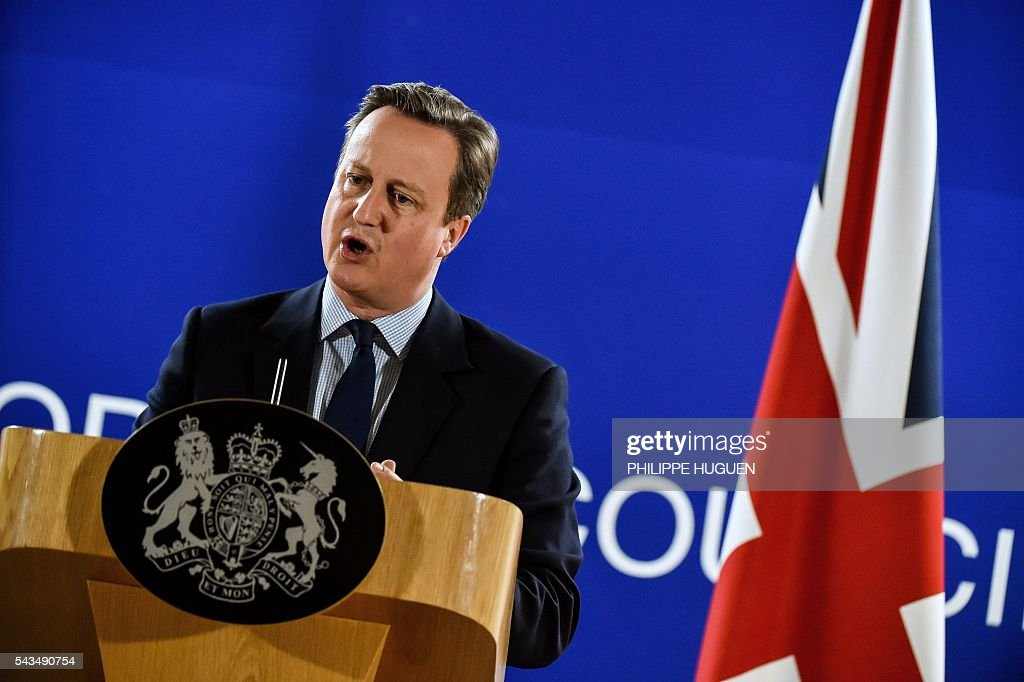 British Prime minister David Cameron gestures as he delivers a speech during a press conference during an European Union summit on June 28, 2016 at the EU headquarters in Brussels. Britain's exit from the European Union may erode the bloc's leadership role in fighting climate change and stymie crucial efforts to set more ambitious targets for cutting greenhouse gases, officials and experts said on June 28. European leaders meeting in Brussels pressured British Prime Minister David Cameron Tuesday to launch the two-year withdrawal process 'as soon as possible', but the embattled premier has vowed he will leave that task to a successor to be named on September 9. / AFP / PHILIPPE