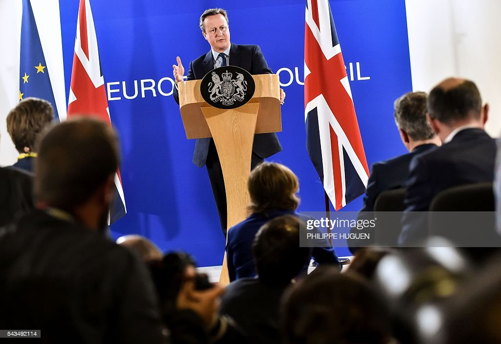 British Prime minister David Cameron gestures as he delivers a speech during a press conference during a European Union summit on June 28, 2016 at the EU headquarters in Brussels. Britain's exit from the European Union may erode the bloc's leadership role in fighting climate change and stymie crucial efforts to set more ambitious targets for cutting greenhouse gases, officials and experts said on June 28. European leaders meeting in Brussels pressured British Prime Minister David Cameron Tuesday to launch the two-year withdrawal process 'as soon as possible', but the embattled premier has vowed he will leave that task to a successor to be named on September 9. / AFP / PHILIPPE