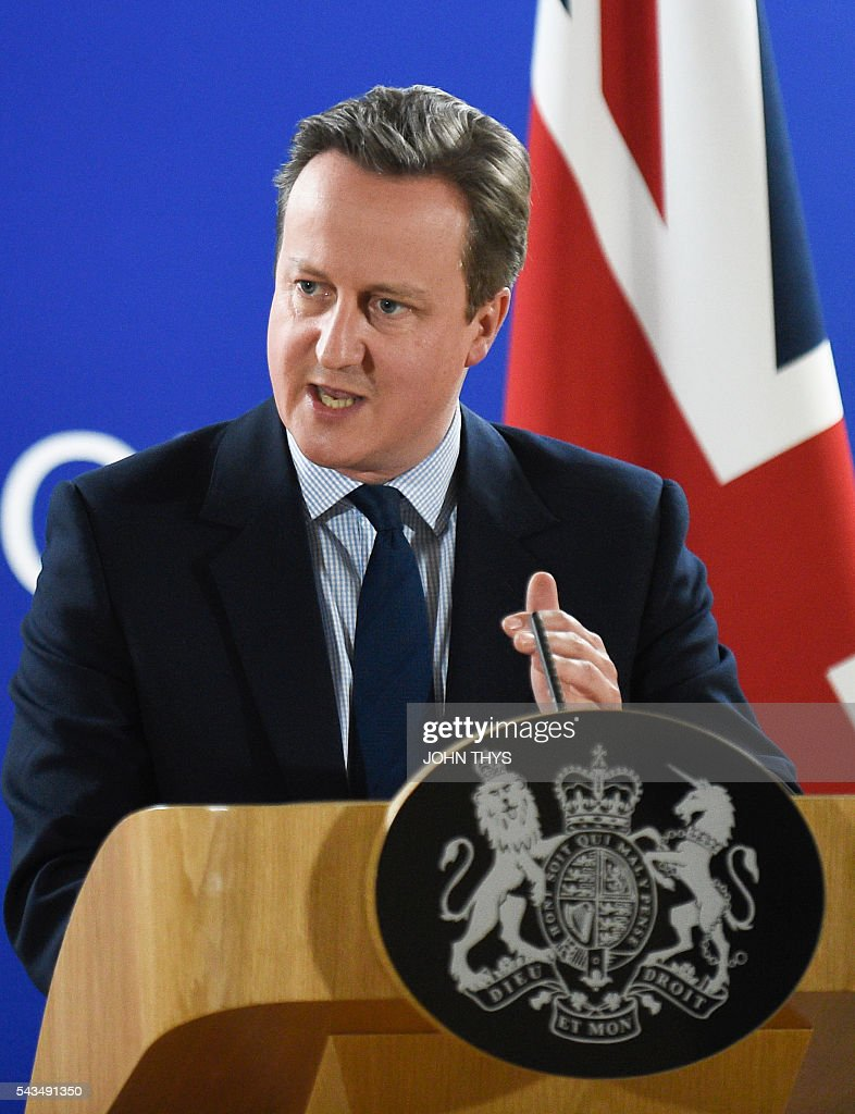 British Prime minister David Cameron gives a press conference during an European Union summit on June 28, 2016 at the EU headquarters in Brussels. Britain's exit from the European Union may erode the bloc's leadership role in fighting climate change and stymie crucial efforts to set more ambitious targets for cutting greenhouse gases, officials and experts said on June 28. European leaders meeting in Brussels pressured British Prime Minister David Cameron Tuesday to launch the two-year withdrawal process 'as soon as possible', but the embattled premier has vowed he will leave that task to a successor to be named on September 9. / AFP / JOHN