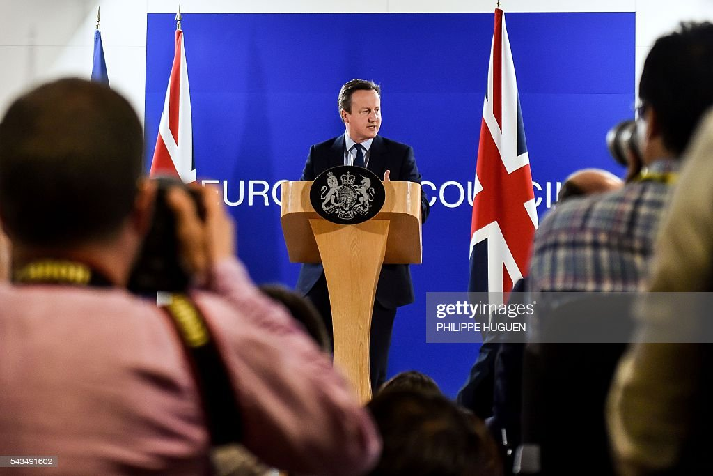 British Prime minister David Cameron gives a press conference during an European Union summit on June 28, 2016 at the EU headquarters in Brussels. Britain's exit from the European Union may erode the bloc's leadership role in fighting climate change and stymie crucial efforts to set more ambitious targets for cutting greenhouse gases, officials and experts said on June 28. European leaders meeting in Brussels pressured British Prime Minister David Cameron Tuesday to launch the two-year withdrawal process 'as soon as possible', but the embattled premier has vowed he will leave that task to a successor to be named on September 9. / AFP / PHILIPPE