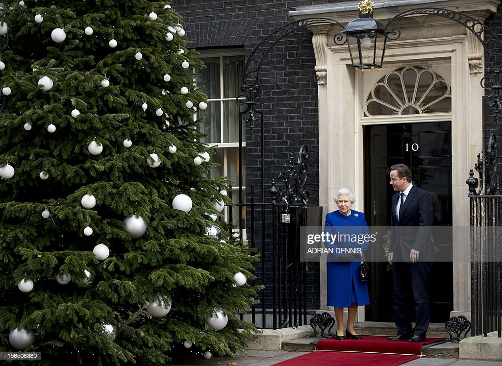 British Prime Minister David Cameron (R) greets Britain's Queen Elizabeth II (L) at the door of no 10 Downing Street in London December 18, 2012 as the monarch arrives to sit in as an observer during a meeting of the Cabinet. Queen Elizabeth II attended her first-ever cabinet meeting on Tuesday to mark her diamond jubilee, the only monarch to do so since 1781.The 86-year-old sovereign sat in as an observer on the meeting and received a gift from the Cabinet to celebrate her 60 years on the throne.