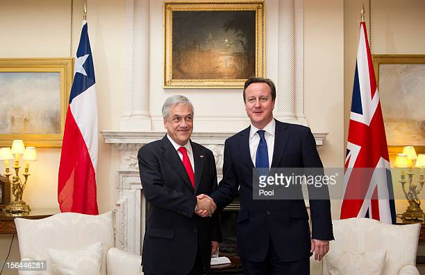British Prime Minister David Cameron greets Chilean President Sebastian Pinera inside 10 Downing Street on November 15 2012 in London England