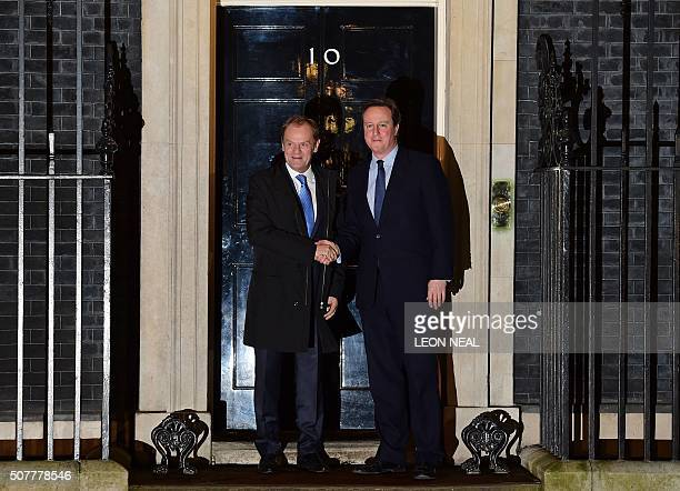 British Prime Minister David Cameron greets European Council President Donald Tusk outside No 10 Downing Street in central London on January 31 ahead...