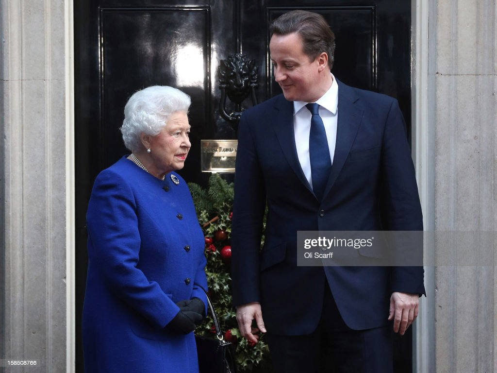 British Prime Minister <a gi-track='captionPersonalityLinkClicked' href=/galleries/search?phrase=David+Cameron+-+Politician&family=editorial&specificpeople=227076 ng-click='$event.stopPropagation()'>David Cameron</a> (R) greets Her Majesty Queen <a gi-track='captionPersonalityLinkClicked' href=/galleries/search?phrase=Elizabeth+II&family=editorial&specificpeople=67226 ng-click='$event.stopPropagation()'>Elizabeth II</a> as she arrives at Number 10 Downing Street to attend the Government's weekly Cabinet meeting on December 18, 2012 in London, England. The Queen's visit to the weekly Cabinet meeting as an observer is the first time a monarch has attended the meeting since Queen Victoria's reign.