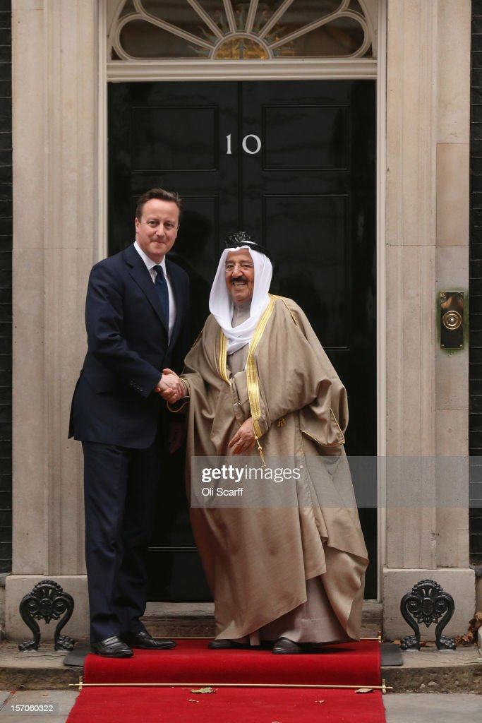 British Prime Minister <a gi-track='captionPersonalityLinkClicked' href=/galleries/search?phrase=David+Cameron+-+Politician&family=editorial&specificpeople=227076 ng-click='$event.stopPropagation()'>David Cameron</a> greets His Highness the Amir Sheikh Sabah Al-Ahmad Al-Jaber Al-Sabah of Kuwait (R) outside Number 10 Downing Street on November 28, 2012 in London, England. The Amir of Kuwait is conducting three-day state visit to the UK. Following his meeting with Prime Minister <a gi-track='captionPersonalityLinkClicked' href=/galleries/search?phrase=David+Cameron+-+Politician&family=editorial&specificpeople=227076 ng-click='$event.stopPropagation()'>David Cameron</a> in Downing Street he will attend a Banquet at the Guildhall.
