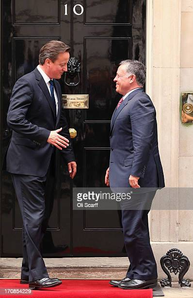 British Prime Minister David Cameron greets His Majesty King Abdullah II of Jordan outside Number 10 Downing Street on June 19 2013 in London England...