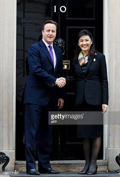 British Prime Minister David Cameron greets his Thai counterpart Yingluck Shinawatra on the steps of number 10 Downing Street in central London on...