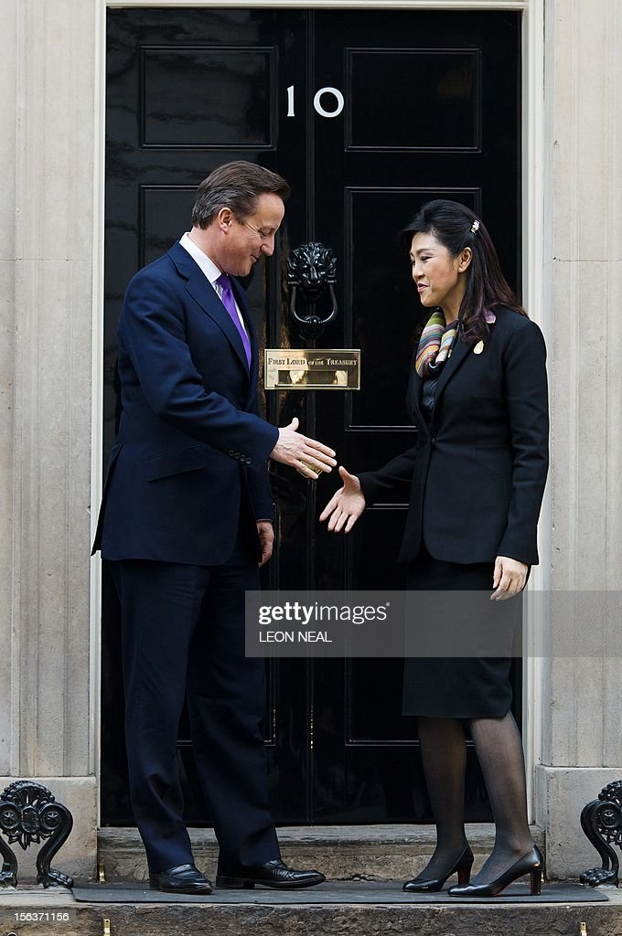 British Prime Minister David Cameron (L) greets his Thai counterpart Yingluck Shinawatra on the steps of number 10, Downing Street in central London on November 14, 2012. Yingluck Shinawatra is on an official visit to Britain during which she has met with Queen Elizabeth II and Prime Minister David Cameron. AFP PHOTO / LEON NEAL