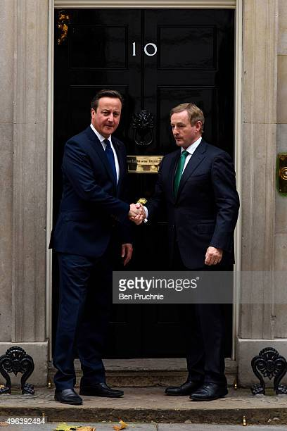British Prime Minister David Cameron greets Ireland's Taoiseach Enda Kenny at Downing Street on November 9 2015 in London England The head of...