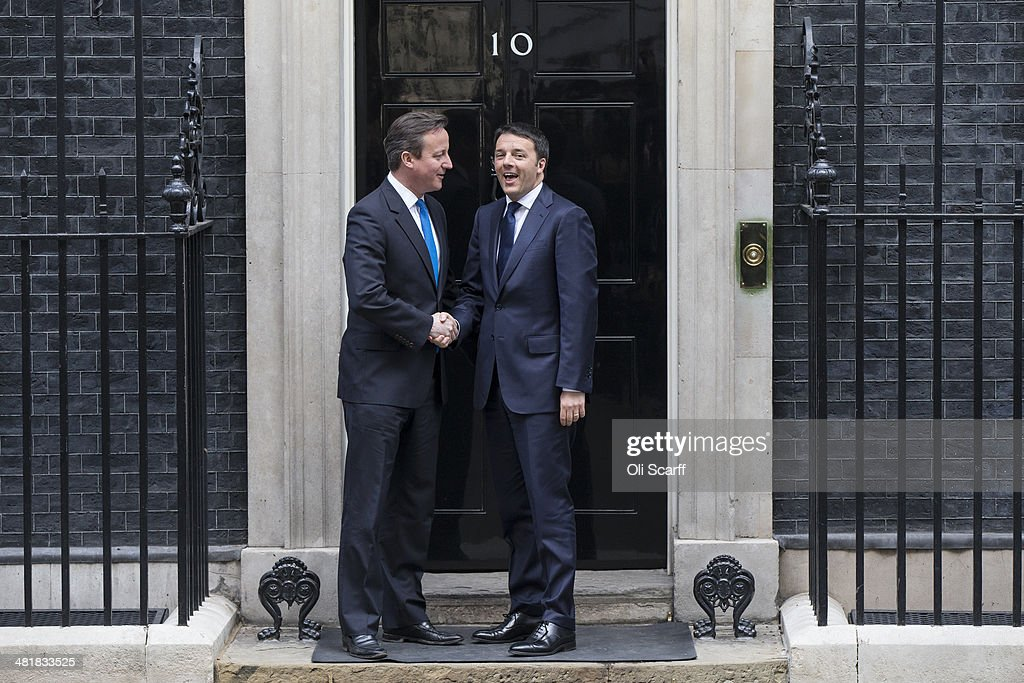 British Prime Minister David Cameron (L) greets Italian Prime Minister <a gi-track='captionPersonalityLinkClicked' href=/galleries/search?phrase=Matteo+Renzi&family=editorial&specificpeople=6689301 ng-click='$event.stopPropagation()'>Matteo Renzi</a> as he arrives in Downing Street on April 1, 2014 in London, England. Mr Renzi is making his first official visit to the UK since coming to power on February 22, 2014.