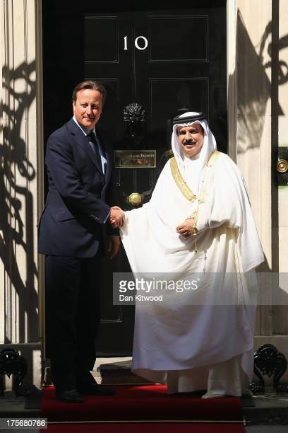 British Prime Minister David Cameron greets King Hamad bin Isa Al Khalifa of Bahrain outside 10 Downing Street on August 6 2013 in London England Mr...